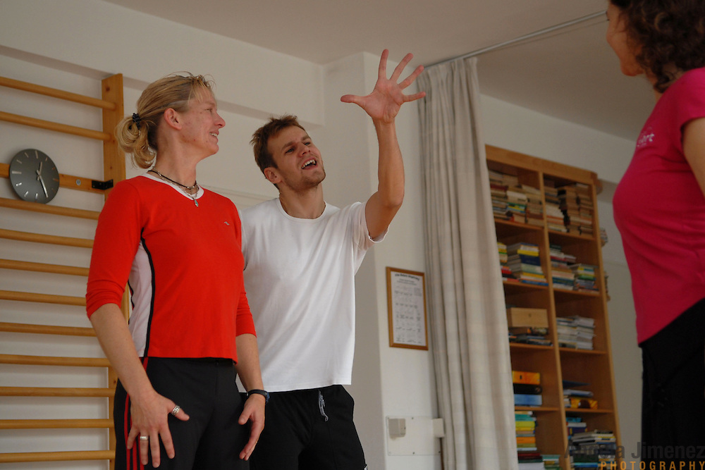 """World Champion same-sex ballroom dancer Robert Tristan Szelei, center, gives a ballroom lesson to female dance couple Denae Wagner, left, and Cindy Mills, both of California, at an apartment belonging to the parents of Szelei's dance partner, Gergely Darabos, in Budapest, Hungary on October 20, 2006. Wagner and Mills were preparing to compete in the 1st Csardas Cup 2006, the first same-sex international championship ever held in Eastern Europe, held on the same day as the 2nd Annual World Championship Same Sex Dancing Competition in Budapest on October 21, 2006. ..Szelei and Darabos, who are known as the """"Black Swans,"""" are the reigning world champions in men?s Latin same-sex ballroom dancing. They competed in the 2nd annual World Championship and the Csardas Cup, the first-ever Eastern European same-sex ballroom competition, the pinnacle event of the blossoming same-sex ballroom scene...Szelei and Darabos went on to win the men?s Standard division and finished fourth in the Latin division. ..The event was organized by the US-based World Federation of Same-Sex Dancing, which hosted the first World Championship Same-Sex championships in 2005 in Sacramento, California. The Black Swans did a large amount of the coordination and planning in Budapest, a city that had never seen an event of this kind. When government funding fell through, they secured funding from patron Desire (accent on the ?e?) Dubounet, owner of the local Club Bohemian Alibi drag club. ..The World Championship events are newly recognized, but same-sex dancers have been competing on a national and international circuit for a number of years, especially in Europe, including at the Eurogames, the Gay Games, the London Pink Jukebox Trophy and the Berlin Open, among others. Countries including the United States, the Netherlands, Germany and, now, Hungary, hold their own national same-sex championships. Hungary held its first national championships in April 2006...Szelei and Darabos spent three months at the"""