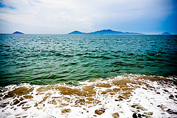 Seascape along Cua Dai Beach with Cham Islands in the far distance, Hoi An, Vietnam, Southeast Asia