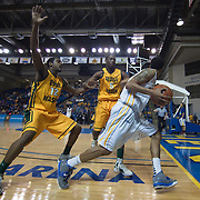 02/01/12 Newark DE: Delaware Freshman Guard #3 Khalid Lewis (Right) attempts to bolt for freedom as George Mason Freshman Forward Vaughn Gray #12 & Sophomore Forward Jonathan Arledge #5 apply relentless pressure late in the second half of a Colonial Athletic Association conference Basketball Game against George Mason Wed, Feb. 1, 2012 at the Bob Carpenter Center in Newark Delaware.