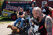 "Rescue Ink, Long Island, New York, taettowierte Motoradgang, Verein zur Rettung mishandelter Hunde und anderer Tierarten.vlnr (left to right):.Joe Panz, Jonny ""O"", ""Batzo"" (in front), ""Big Ant"" mit Pitbull 'Rebel' vor dem Vereinshaus in Long Island..Rescue Ink rettete dem Pitbull 'Rebel' das Leben, er war in Virginia als Koeder fuer Kampfhunde eingesetzt worden und erlitt schwerste Verletzungen. ..Rescue Ink, the animal rescue group that brings an in your face approach to the fight against animal abuse and neglect. The goups members are heavily tattooed and ride motorbikes. Their pitbull 'Rebel', who lives at their headquarters, was rescued from a dog fighting operation, where he was used as bait. He was near death when two members of Rescue Ink flew to Virginia to save him...Foto © Stefan Falke."