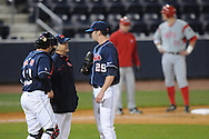 Ole Miss Head Coach Mike Bianco (5)talks to Ole Miss' Matt Tracy (29) and Ole Miss' Taylor Hightower (13) at Oxford-University Stadium in Oxford, Miss. on Wednesday, March 9, 2010.