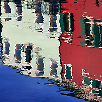 A classic take of the crazy colours of Burano's houses reflected in a canal. Stitched from five verticals.