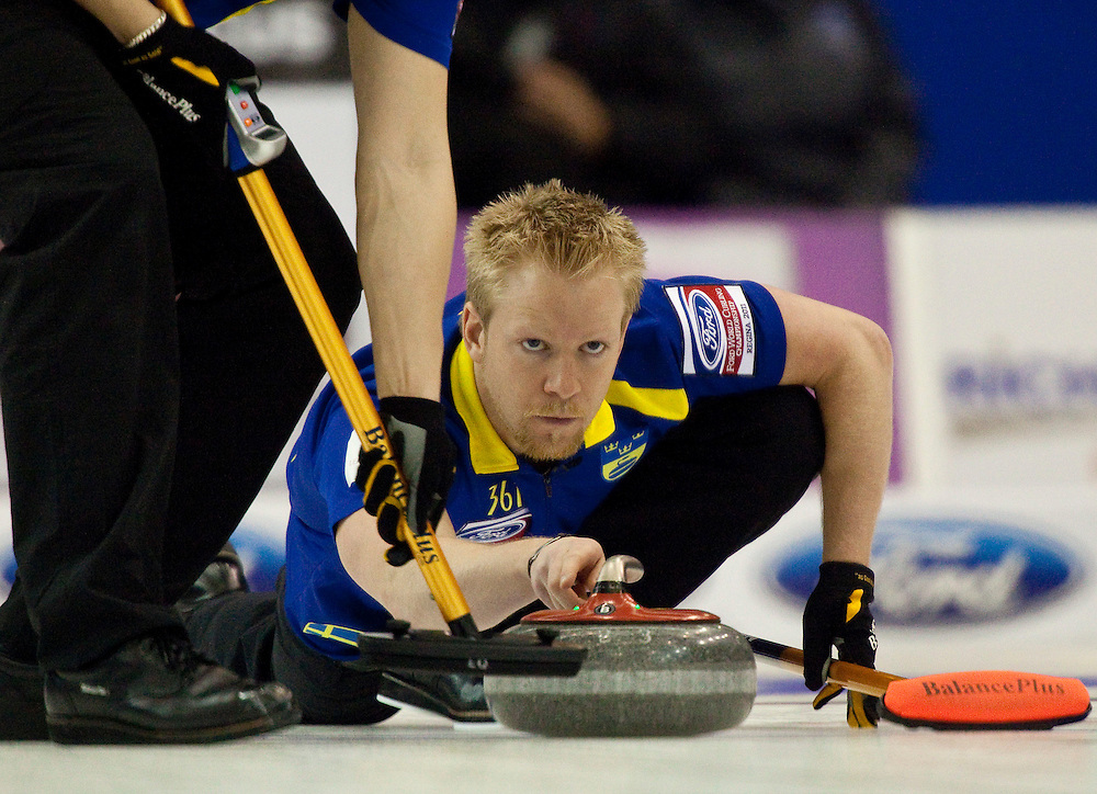 during their 3-4 page playoff match at the Ford World Men's Curling Championships in Regina, Saskatchewan, April 9, 2011.<br /> AFP PHOTO/Geoff Robins