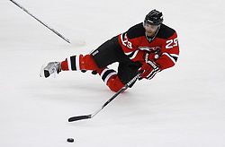 Feb 9, 2009; Newark, NJ, USA; New Jersey Devils defenseman Johnny Oduya (29) gets tripped up during the second period at the Prudential Center.