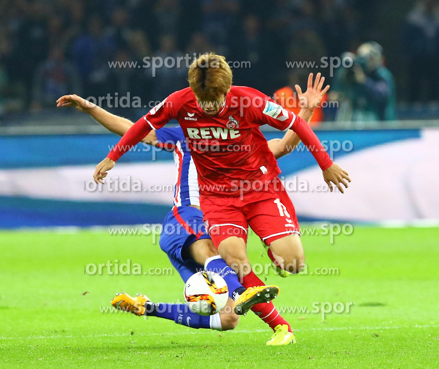 22.09.2015, Olympiastadion, Berlin, GER, 1. FBL, Hertha BSC vs 1. FC Koeln, 6. Runde, im Bild Per Ciljan Skjelbred (#3, Hertha BSC Berlin) foult Yuya Osako (#13, 1. FC Koeln) // during the German Bundesliga 6th round match between Hertha BSC and 1. FC Cologne at the Olympiastadion in Berlin, Germany on 2015/09/22. EXPA Pictures &copy; 2015, PhotoCredit: EXPA/ Eibner-Pressefoto/ Hundt<br /> <br /> *****ATTENTION - OUT of GER*****