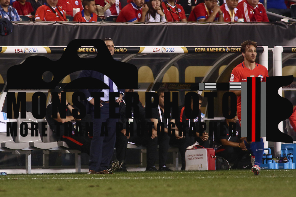 Chile Manager JUAN ANTONIO PIZZI watches the game from the sidelines in the first half of a Copa America Centenario Group D match between the Chile and Panama Tuesday, June. 14, 2016 at Lincoln Financial Field in Philadelphia, PA.