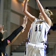 Delaware Junior Forward (#11) Elena Delle Donne takes the jump shot scoring 2 of her 31 points during VCU delaware game at the The Bob Carpenter Center In Newark Delaware Thursday Night.