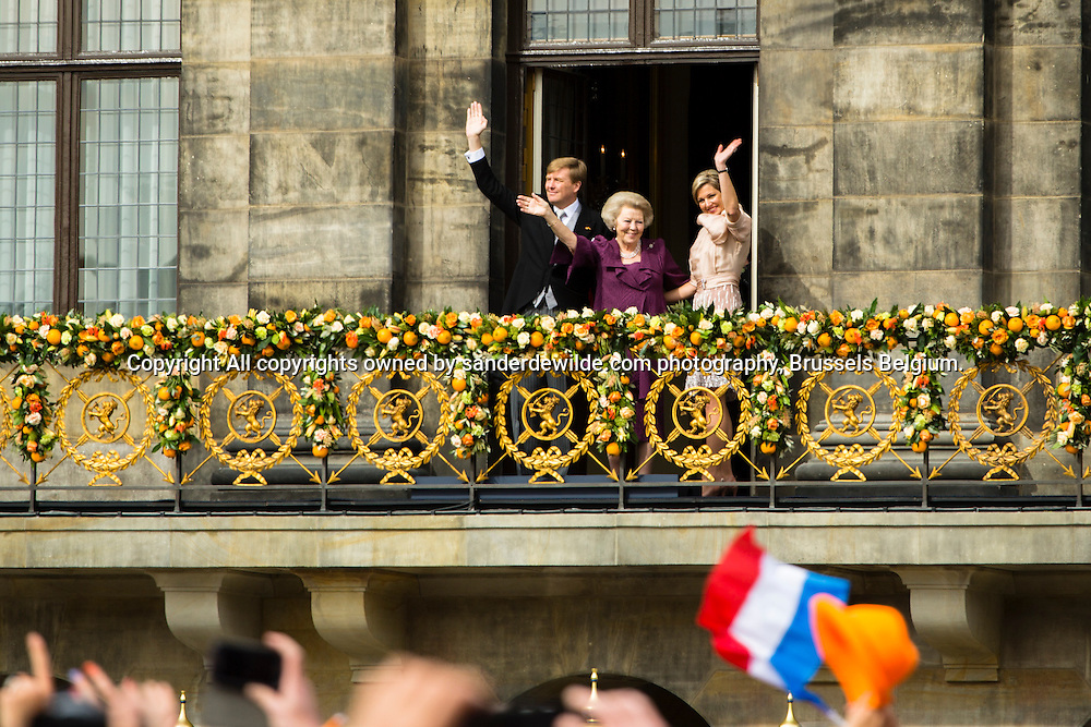 30th April 2013 Amsterdam, Netherlands. Dam Square. Queen Beatrix' abdication takes place, and her son Prince Willem-Alexander will be King of the Netherlands. from left to right King Willem Alexander, princess Beatrix and queen maxima wave at the thousands enthousiast Dutch from the balcony