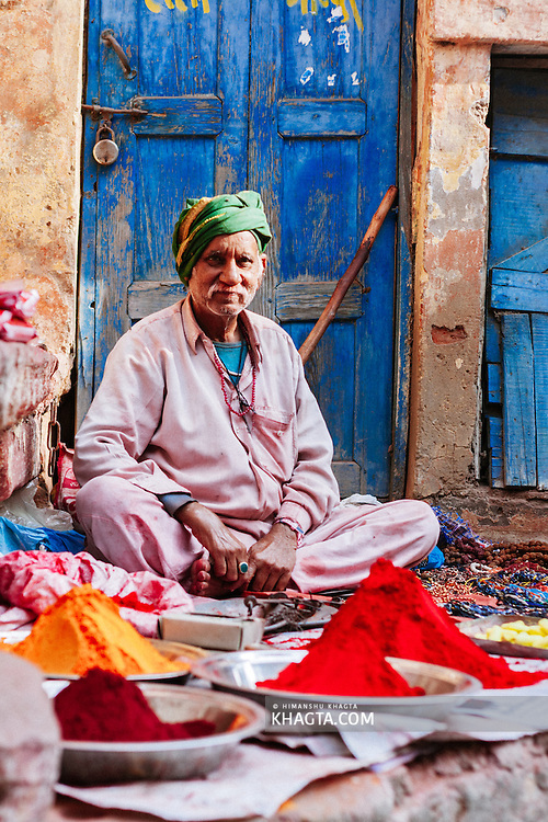 An old man selling religious stuff in the street of Mathura. Mathura is a sacred town situated on the banks of Yahuman river in Uttar Pradesh, northern India. The birthplace of the deity Lord Krishna. It is a pilgrimage site for Hindus.