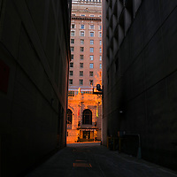 WA10104-00...WASHINGTON - Narrow alley leading to the Olympic Hotel at sunset.