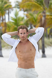 sexy man at the beach with an open shirt