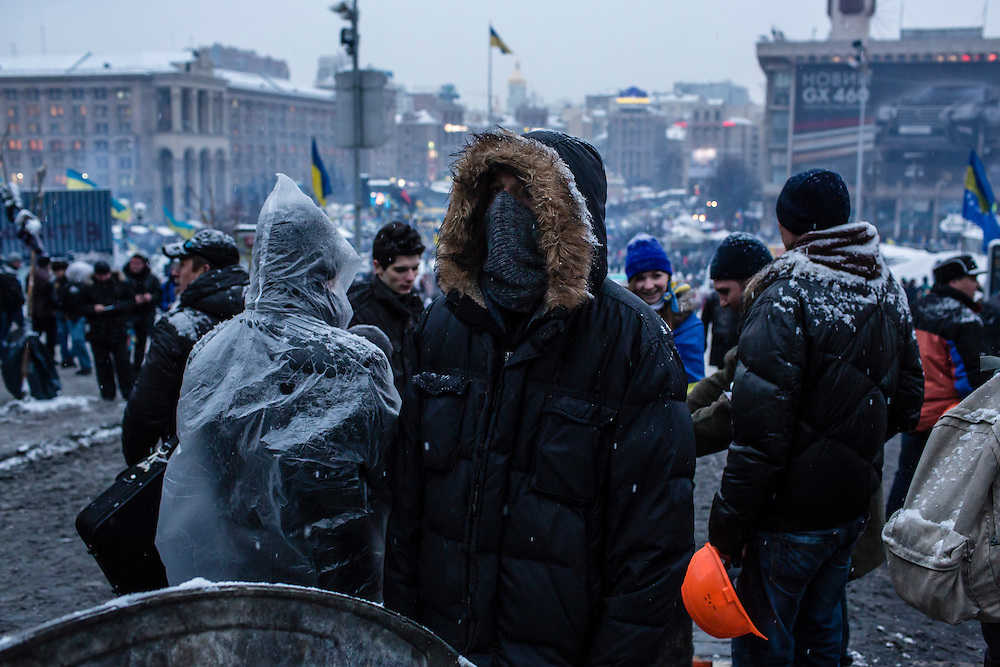 KIEV, UKRAINE - DECEMBER 11: An anti-government protester tries to keep warm near Independence Square, known as the Euromaidan, on December 11, 2013 in Kiev, Ukraine. Thousands of people have been protesting against the government since a decision by Ukrainian president Viktor Yanukovych to suspend a trade and partnership agreement with the European Union in favor of incentives from Russia. (Photo by Brendan Hoffman/Getty Images) *** Local Caption ***