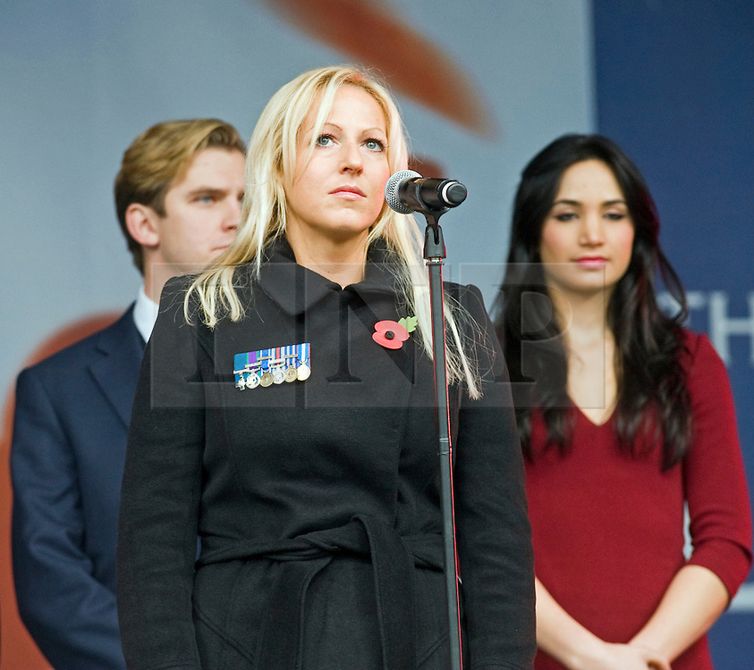 © London News Pictures. 11/11/2011. London, UK. Christina Schmid, the wife of Staff Sergeant Olaf Schmid who was killed in afghanistan talking before a 2 minute silence at a Remembrance day ceremony at Trafalgar Square, London today (11/11/2011) . Photo Credit : Ben Cawthra/LNP