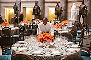 A caterer arranges place settings ahead of the Inaugural luncheon in Statuary Hall in the U.S. Capitol on Monday, January 21, 2013 in Washington, DC.