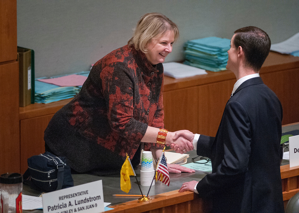 em031817n/a/Rep. Deborah Armstrong, D-Albuquerque,  and Rep. Jason Harper, R-Rio Ranco, shake hands as the 2017 Legislative Session omes to an end. This was at the Roundhouse in Santa Fe, Saturday March 18, 2017. (Eddie Moore/Albuquerque Journal