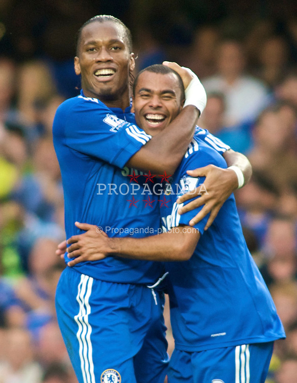 LONDON, ENGLAND - Sunday, September 20, 2009: Chelsea's Didier Drogba celebrates scoring the third goal against Tottenham Hotspur with team-mate Ashley Cole during the Premiership match at Stamford Bridge. (Pic by Gareth Davies/Propaganda)
