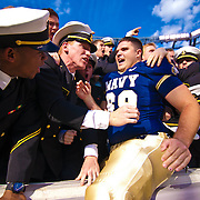 Navy OG (#69) Francis Archibald and the Navy Midshipmen celebrate as Navy defeats Notre Dame 35-17 at The New Giant's Stadium in East Rutherford New Jersey