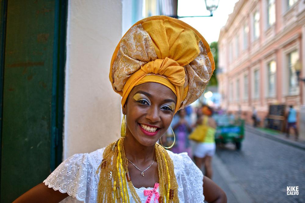 Portrait of a Bahian woman in traditional dress at the Pelourinho district, Salvador (Salvador de Bahia), Bahia, Brazil.