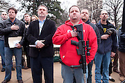 Gun rights supporters gathered in front of the Georgia Capitol for the &quot;Georgia Second Right Rally.&quot; <br /> <br /> A fired-up Ray McBerry of Georgia First stood under a red, white, and blue banner and denounced President Obama. &quot;We don't intend to allow a foreign-born Marxist in the White House, or his Marxist attorney general, to destroy 200 years of American liberty,&quot; McBerry said. He added that &quot;We don't plan on allowing them to use staged crisis events to have pretext for destroying American liberties.&quot; He was answered with applause and cheers.<br /> <br /> When asked after his speech if he was referring to the recent mass shootings in Newtown, Conn., and Aurora, Colo., as &quot;staged crisis events,&quot; McBerry said he would &quot;let people take it how they want to.&quot; <br /> <br /> Many people in the crowd came toting semi-automatic weapons, including Dwayne Locklear (pictured). The Rome, Ga., resident stood with his AR-15 across his chest and placed his hand over his heart during the morning's Pledge of Allegiance. &quot;I am practicing my Second Amendment rights,&quot; he said. &quot;You gotta keep the government in check and protect my home, family, and property.&quot;