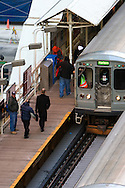 Rush hour riders scramble to board a westbound Green Line CTA L train in Chicago's Loop.
