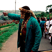POLITICS CONFLICT SOUTH AFRICA MAR 1995: A traditional Zulu chief fires a revolver at African National Congress supporters during a march in Umlazi township outside Durban, KwaZulu Natal in 1995.  The war between the ANC and Inkatha in KwaZulu Natal has cost thousands of lives. (Photo by Greg Marinovich )