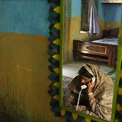 Mukhtar Mai, 33, talks to her lawyer about developments in her case, Meerwala, Pakistan, April 27, 2005. Mai, went against the Pakistani tradition of committing suicide when she brought charges against the men who gang raped her nearly three years ago.