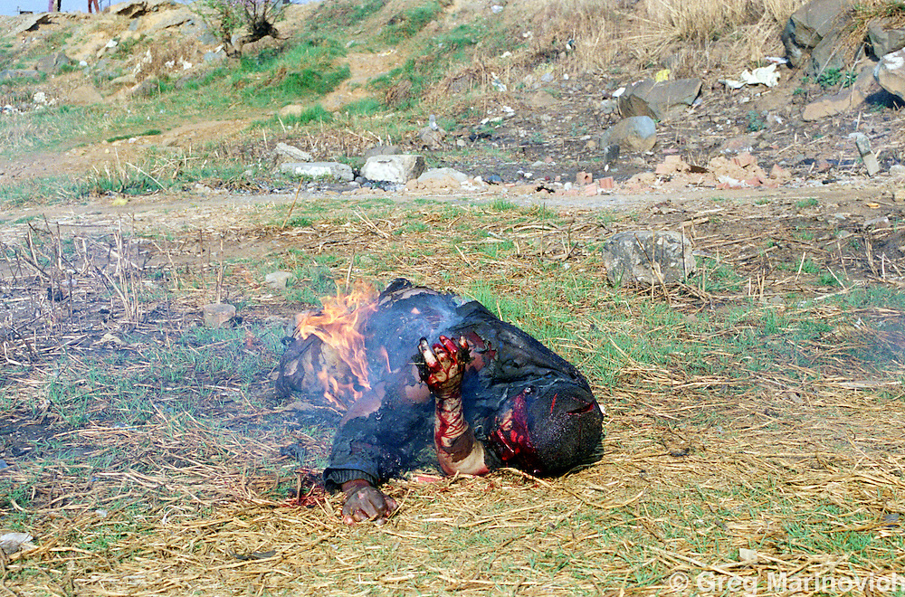 Lindsaye Tshabalala was stabbed and burnt to deatrh by ANC supporters when he was identified as a Zulu Inkatha supporter in Onhlazana, Soweto. 15 September 1990 (Part of Pulitzer series)
