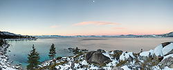 """""""Sand Harbor Sunrise 2"""" - Stiched Panoramic photograph of Sand Harbor in the distance shot at sunrise, the moon can be seen in the photo."""