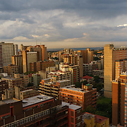A view of Hillbrow, an inner-city neighbourhood in Johannesburg, South Africa with a reputation for drugs, violence and crime. During the apartheid era, Hillbrow was the exclusive domain of wealthy white South Africans. During the unrest of 1980s black South Africans began to move into the area in defiance of the Group Areas Act, which decreed who could be where according to the colour of their skin. The whites moved out, taking their money with them, and the neighbourhood began a steady decline. After the advent of majority rule, poor black South Africans flooded into the inner city seeking a better life, and today the area is characterised by over-crowding, grinding poverty and drug problems.