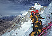 Kitty Calhoun and Jay Smith embrace at a belay while attempting the North face of Thelay Sagar, India