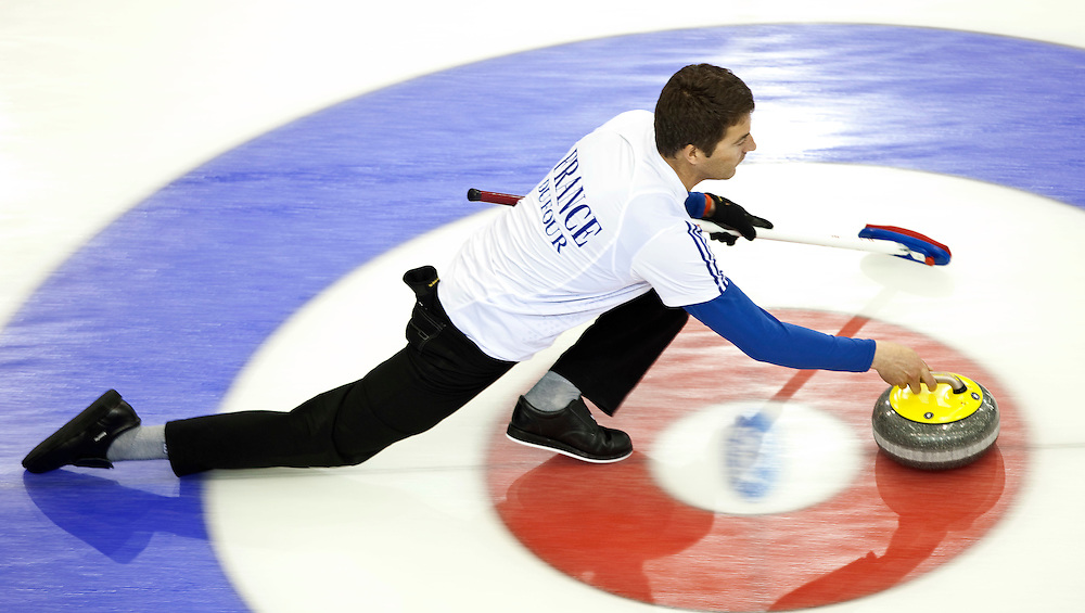 France's skip Thomas Dufour delivers his stone during Norway's 5-4 victory over France in a tie breaker at the Ford World Men's Curling Championships in Regina, Saskatchewan, April 8, 2011.<br /> AFP PHOTO/Geoff Robins