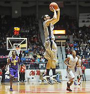 "Mississippi's Marshall Henderson (22) makes a three pointer against LSU at the C.M. ""Tad"" Smith Coliseum in Oxford, Miss. on Wednesday, January 15, 2013. (AP Photo/Oxford Eagle, Bruce Newman)"