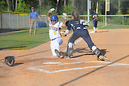 Oxford High's Deryannae Mathis (5) is tagged out by Pearl catcher Cailee Arender (31) in MHSAA Class 5A playoff action in Oxford, Miss. on Friday, April 25, 2014.
