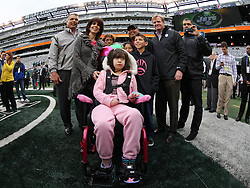 Oct 28, 2012; East Rutherford, NJ, USA; Former New York Jet Joe Klecko (l) and NFL Commissioner Roger Goodell pose with Dante Cano, and his mother Laurie, sister Daniella, and father Jose before the game between the New York Jets and the Miami Dolphins at MetLIfe Stadium.