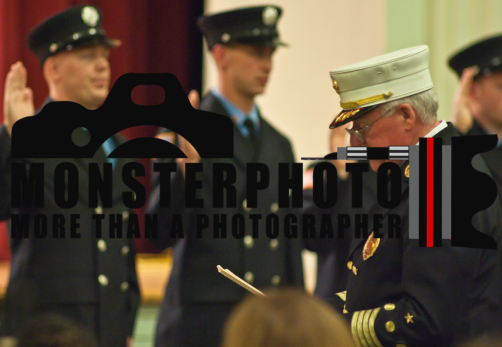 10/16/11 Wilmington DE:  Fire Academy Graduates taking the oath of office during Wilmington Fire Academy Graduation Ceremony Monday, Oct. 17, 2011 at P.S. Dupont Middle school in Wilmington Delaware...Funding for 13 of the 14 members of the current class is coming from a controversial grant approved by City Council this past spring...The 13 men and one woman make up the 36th Wilmington Fire Department Academy, which will bring the department up to 173 members...The News Journal/SAQUAN STIMPSON