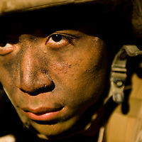 Marine Corps recruit Vu Ho watches his perimeter during training at Parris Island, S.C., on Nov. 24, 2007. (Photo by Stacy L. Pearsall)
