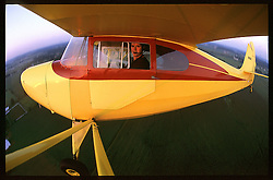 Aeronca Chief in the pattern over the grass runway at Goshen, IN