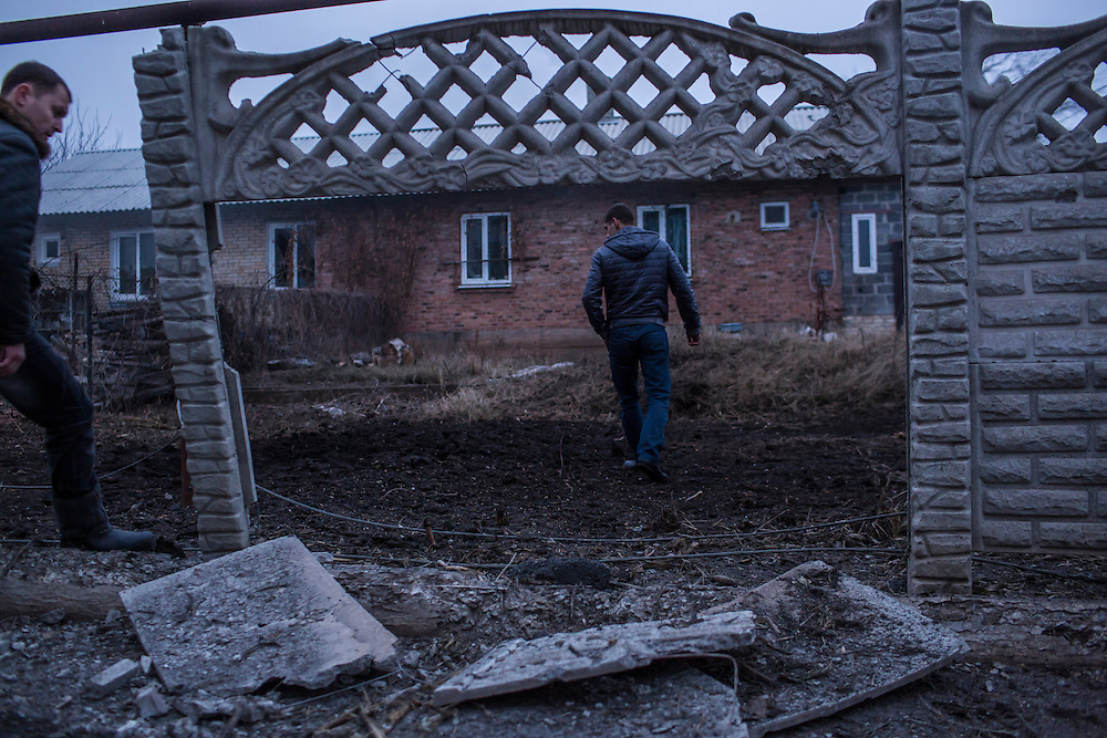 ARTEMIVSK, UKRAINE - FEBRUARY 14: Men examine the scene of an artillery strike on February 14, 2015 in Artemivsk, Ukraine. A ceasefire between Ukrainian forces and pro-Russian rebels is scheduled to go into effect at midnight. (Photo by Brendan Hoffman/Getty Images) *** Local Caption ***