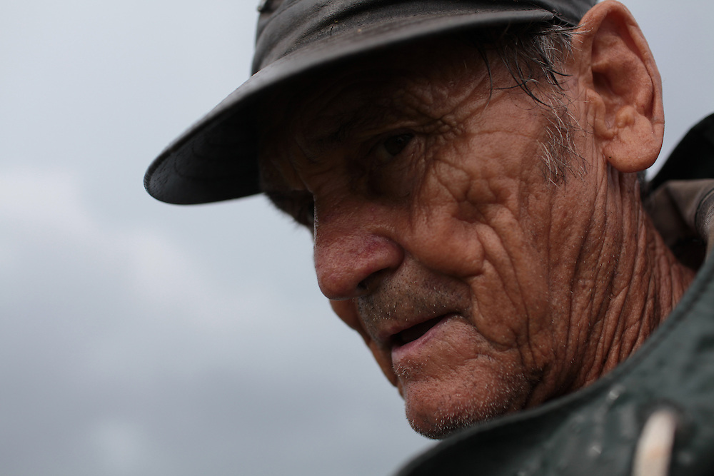 Thomas Gonzales, 72, gator hunting from Delacroix Island, LA August 31, 2010. Last week he finished crabbing because the price dropped to $1.25 for the 1's and it wasn't worth the bait and gas to continue. Thomas is one of the only Delacroix fishermen not working for BP.