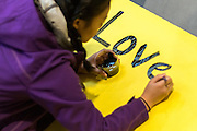Faculty and students gathered to paint posters and walk to the INB Performing Arts Center to partake in the Martin Luther Kind Jr. Day walk through the streets of Downtown Spokane. (Photo by Matt Weigand)