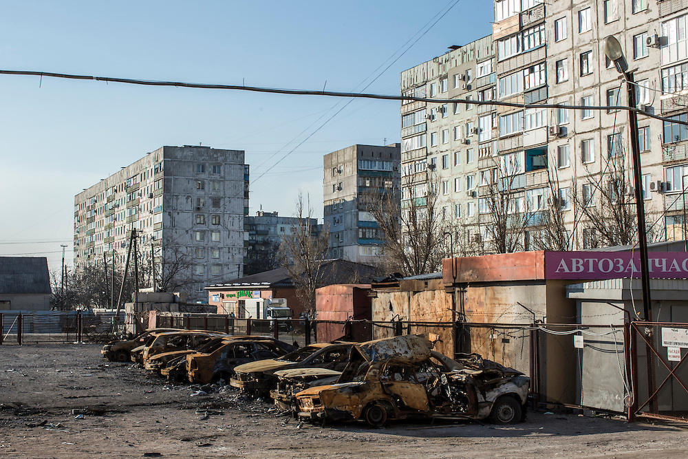 The burned remains of cars are still parked in a lot near the Kievsky Market, which on January 24 suffered a direct hit by a number of Grad rockets, on Sunday, March 8, 2015 in Mariupol, Ukraine. Photo by Brendan Hoffman, Freelance