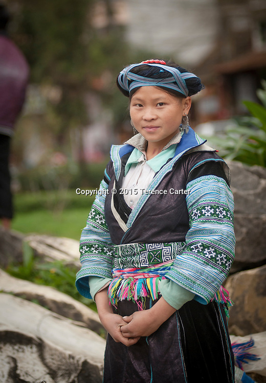 A hilltribe woman with her distictive outfit in the streets of Sapa, Vietnam.