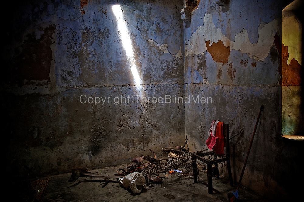 Abandoned room with chair.<br /> A traditional Natcharam (square courtyard) house in Vattukottai.<br /> Jaffna homes. 2011
