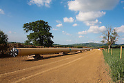 Wormington to Sapperton high pressure Gas Pipeline in the Cotswolds waiting to be buried in a field near Hailes, Gloucestershire, England