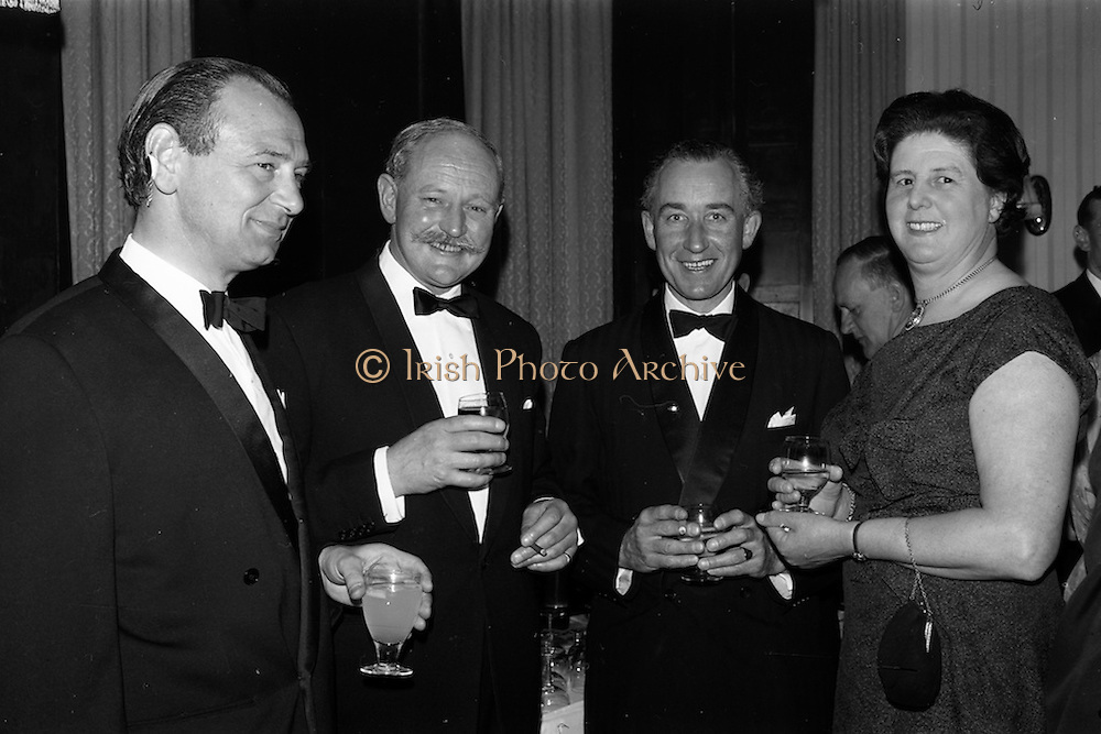 08/05/1964<br /> 05/08/1964<br /> 08 May 1964<br /> Reception and buffet dinner-dance for 5th Annual Tara Cup Rotterdam - Dublin Air Rally given by J.H. Van Anrooy at the Glencormac House Hotel, Co. Wicklow. At the event were (l-r): Mr. J.H. Van Anrooy; Mr. J.T.V. Hamilton; Mr. E.C. Van Hoey Smith and Mrs J.T.V. Hamilton.