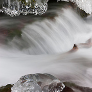"Wahkeena Creek flows by crystal-like icy formations after a week of subfreezing temperatures on the Oregon side of the Columbia River Gorge. Wahkeena is a phase from the Yakima Native American tribe, which means ""most beautiful."""