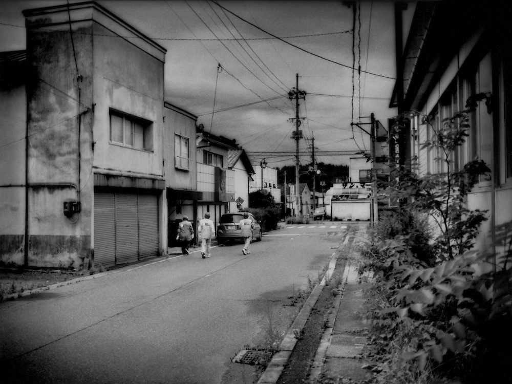 A neighborhood watch patrol in the evacuated village of Iitate-mura.  No date has been set for when this irradiated village will be safe for its residents to return.  It is too highly radioactive.  Iitate-mura, Fukushima Prefecture, Japan.