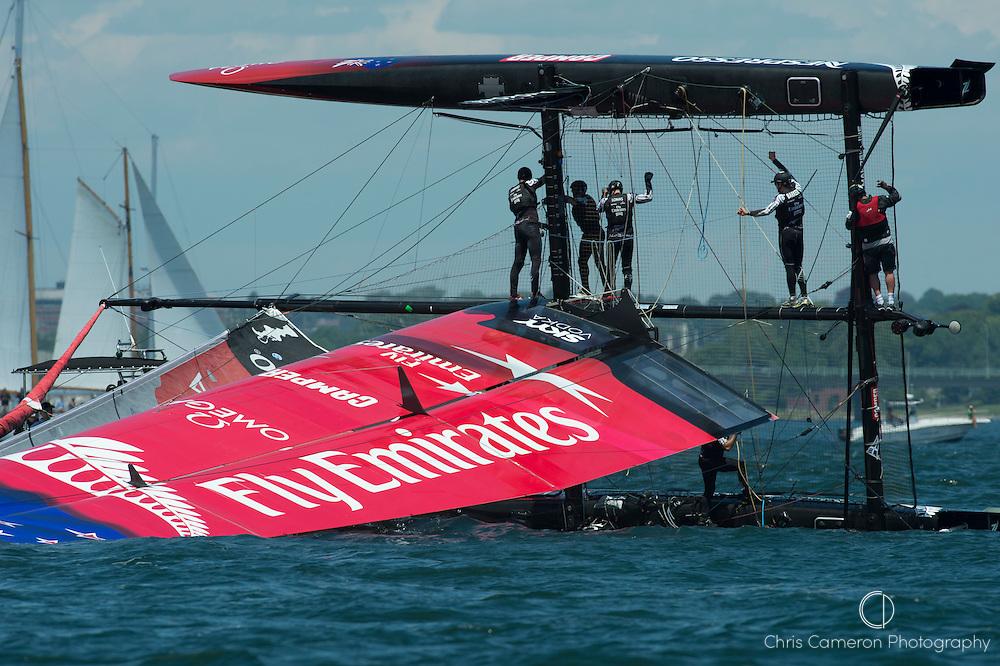 Emirates Team New Zealand capsizes at the first top mark in their first match race against Luna Rossa Piranha. America;s Cup World Series Regatta in Newport, Rhode Island, USA. 28/6/2012