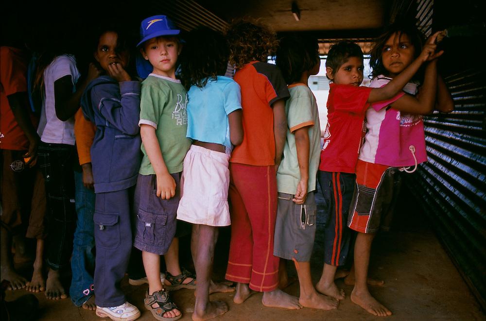 YIYILI Store - Kids outside the store R to L, Adoniah, Shonetta, Adiliah,Tuwannah, Vondella, Dylan and Charlotte.  .