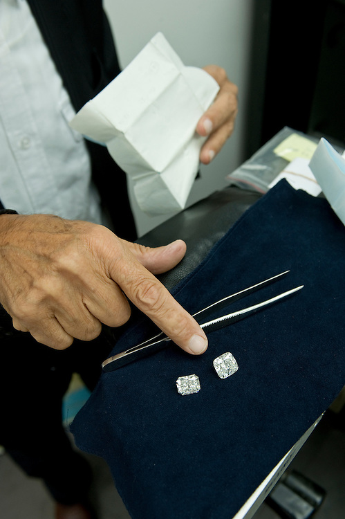 The 17 and 1/2 carat 'radiant cut' diamond (left) is worth approximately  US$ 800.000 , the 11 carat 'cushion shape' diamond (right) approximately US$ 400.000. Both shown at a diamond dealer's office on 47th street...Diamond District New York on 47th street between 5th and 6th avenues in midtown Manhattan . The Diamond District is the world's largest shopping district for all sizes and shapes of diamonds and fine jewelry. Many suppliers and jewelry makers also have their stores and workshops right on 47th street.